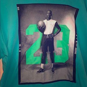 Like a teal Jordan shirt never worn it!! I promise